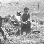 Sitting on a rock, Simms Flash Spotter to left and radio behind and in the customary working gear. It is very different attire to that I wore up on West Down Ranges at Larkhill in the preceding October!