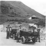 Having finished a day's survey we head back to the barracks of the 58th in Kowloon. To the left is Jock Robertson, the driver of the jeep, John Flann and to the right Sergeant Mason. This illustrates the small numbers involved in a survey party. The survey gear is in the jeep trailer. Ian Styles was probably the photographer.